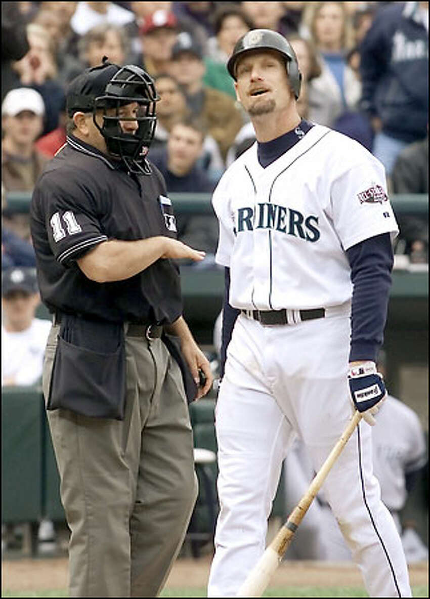 Jay Buhner strikes out and objects to the call as umpire Ed Montague shows him where it was in the ALCS Game 1, Oct. 17, 2001.
