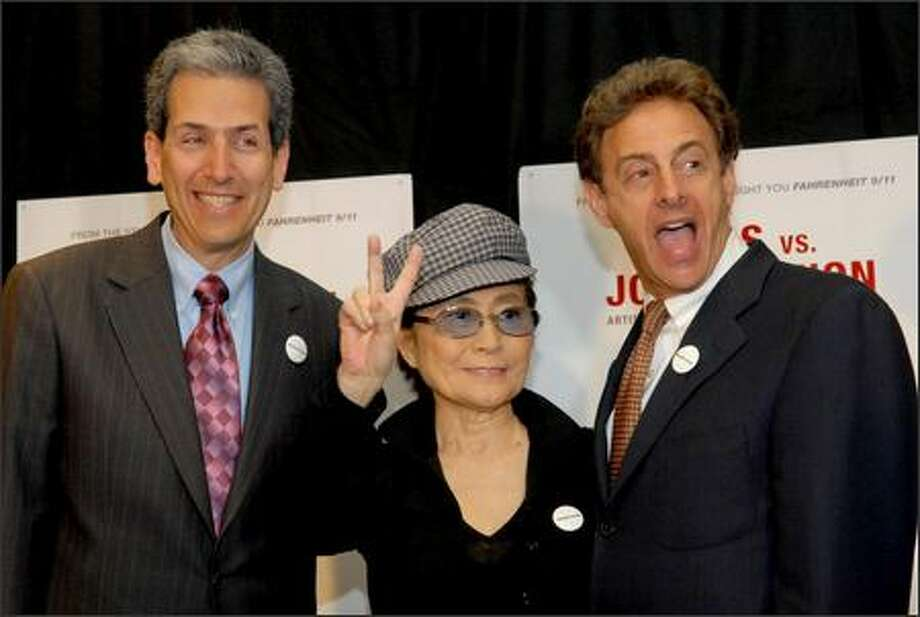 "Yoko Ono Lennon poses with filmmakers David Leaf, left, and John Scheinfeld after talking about their new film ""The U.S. vs. John Lennon"" during a press conference at The Regency Hotel Wednesday in New York. The ex-Beatle's celebrated battle with the feds is chronicled in documentary, which traces how he went from rock star to fierce anti-war protester to ""undesirable alien."" The documentary played at the Toronto Film Festival in advance of its theatrical debut Friday. (AP Photo/Paul Hawthorne)"