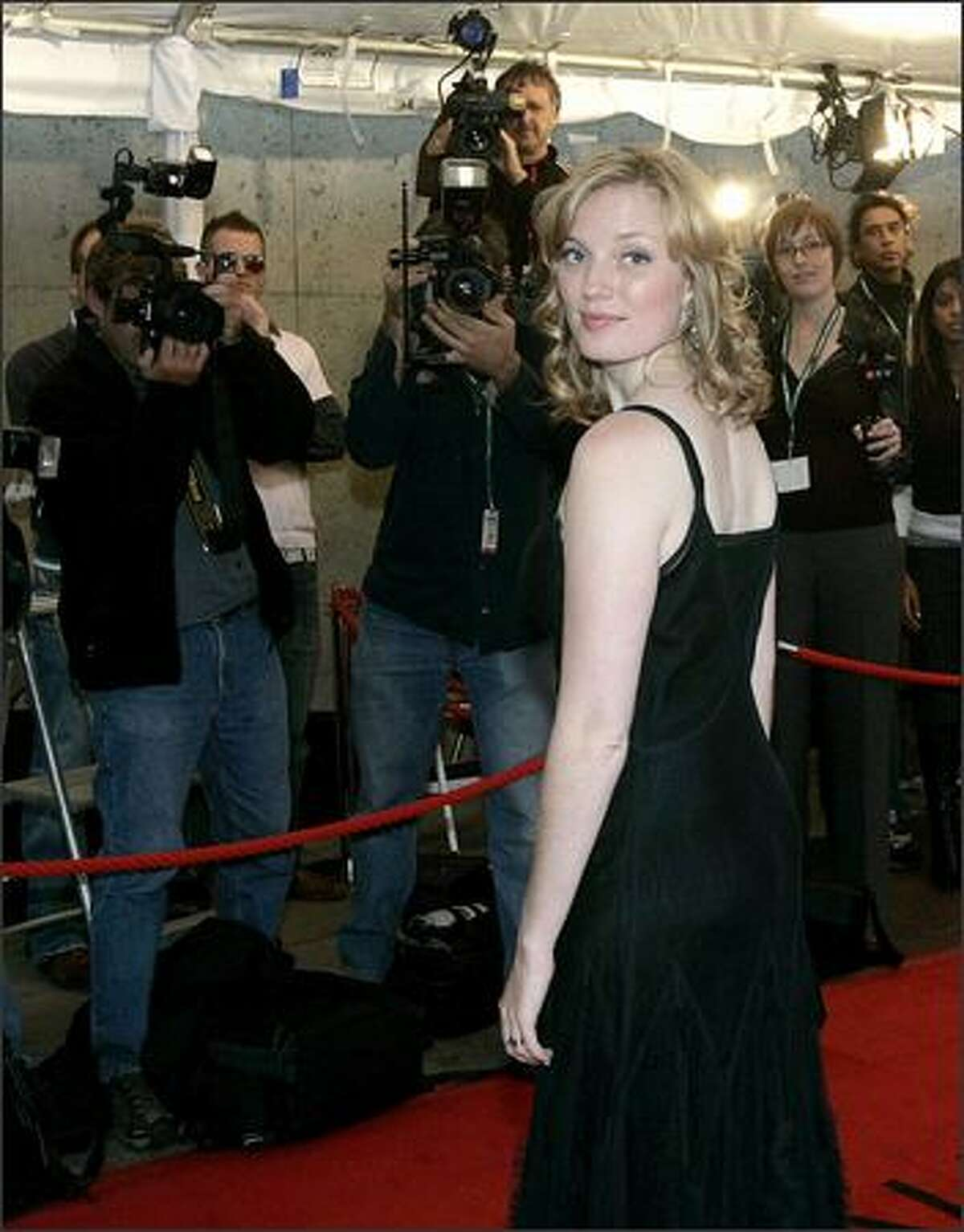 Director Sarah Polley poses for photographers while attending the