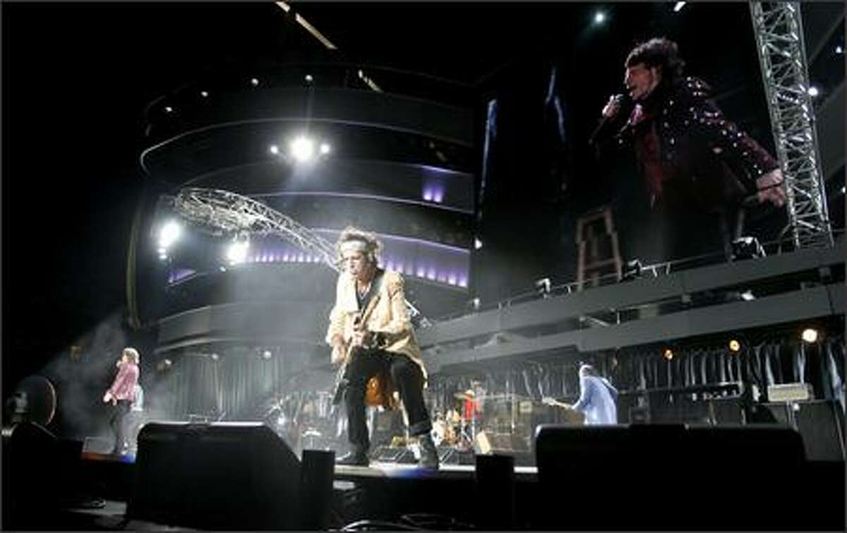 Rolling Stones guitarist Keith Richards preens for the fans. Richards turns 63 on Dec. 18.