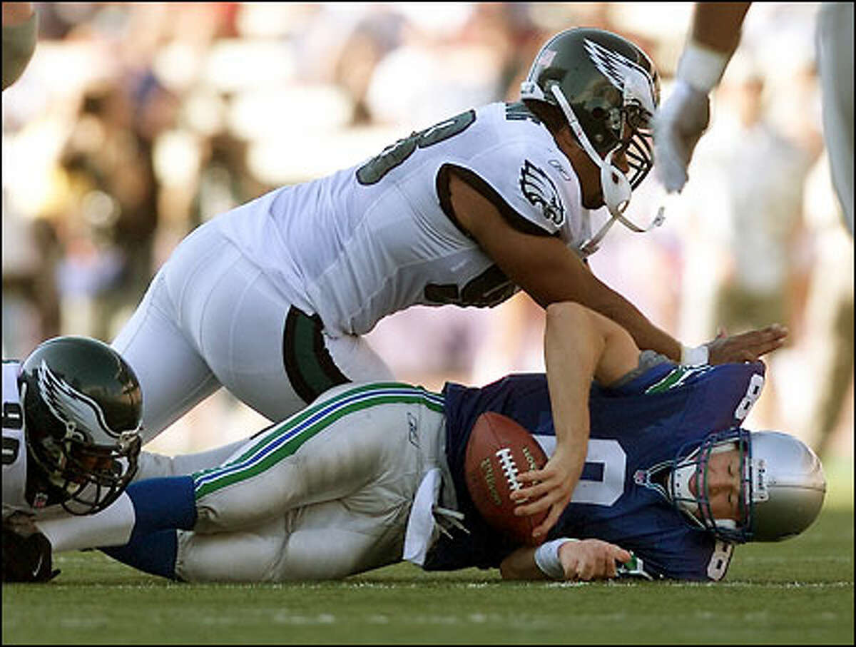 Matt Hasselbeck is sacked by Philadelphia's Brandon Whiting in the third quarter for a five-yard loss.