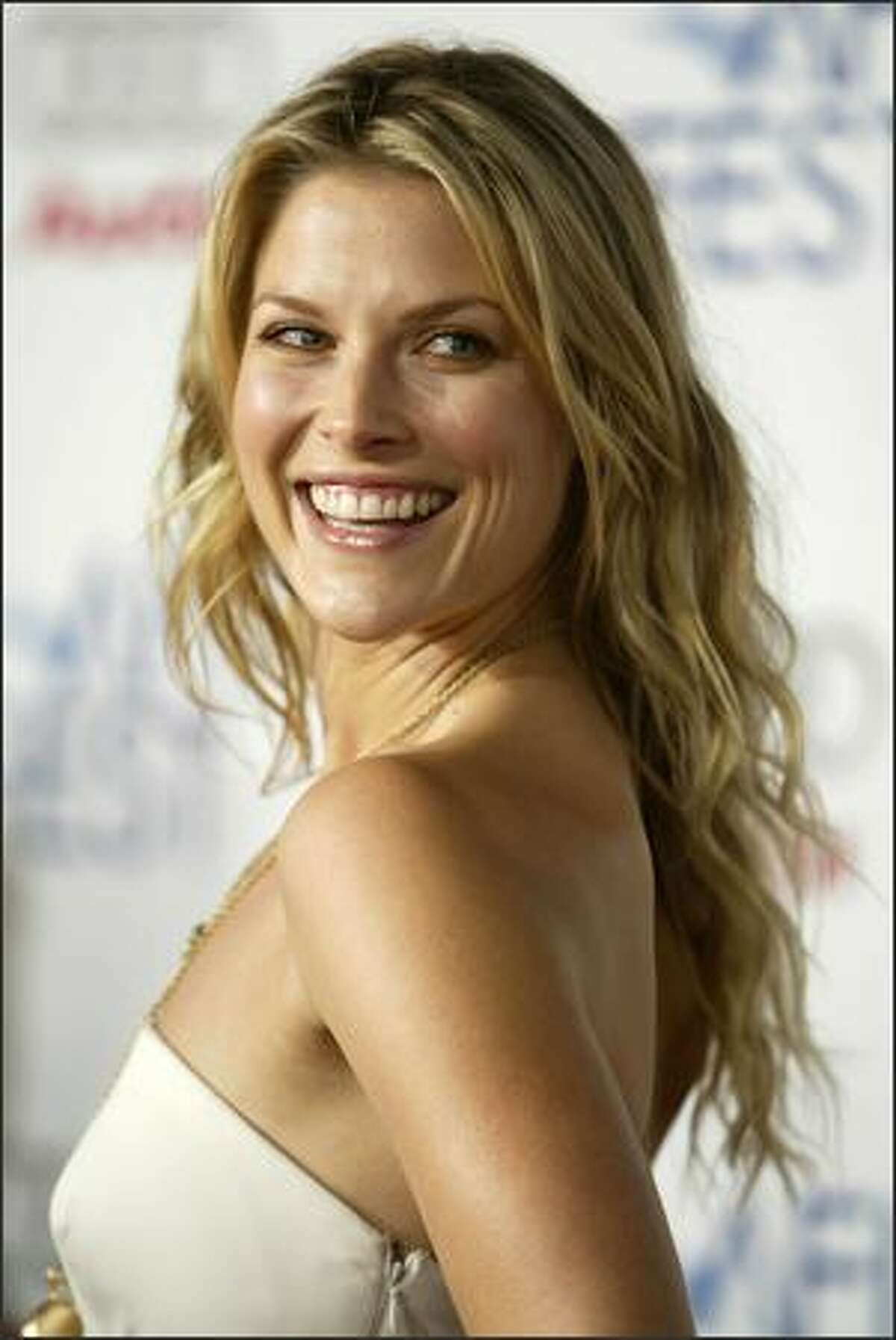 """Actress Ali Larter arrives for the premiere of the movie """"Bobby"""" during the opening night of AFI Fest 2006, Wednesday in Los Angeles. (AP Photo/Danny Moloshok)"""