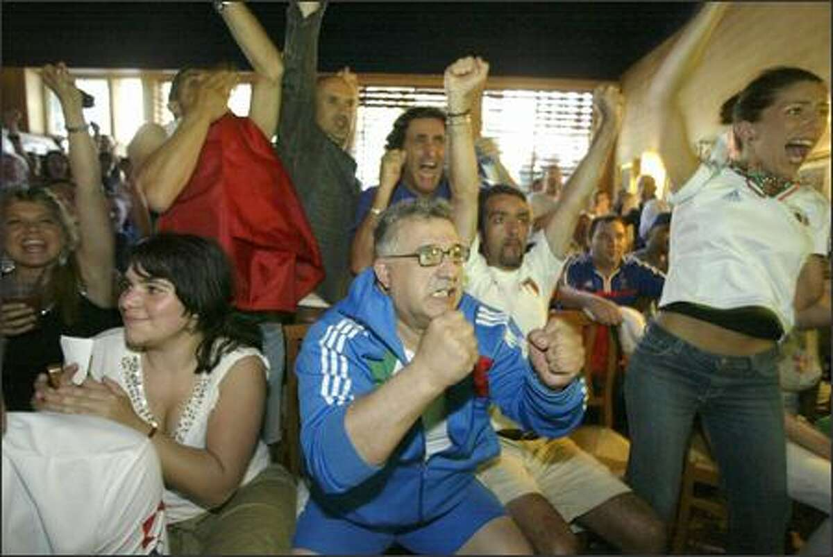 Mario Vellotti celebrates with other Italian fans during the penalty shootout against France.