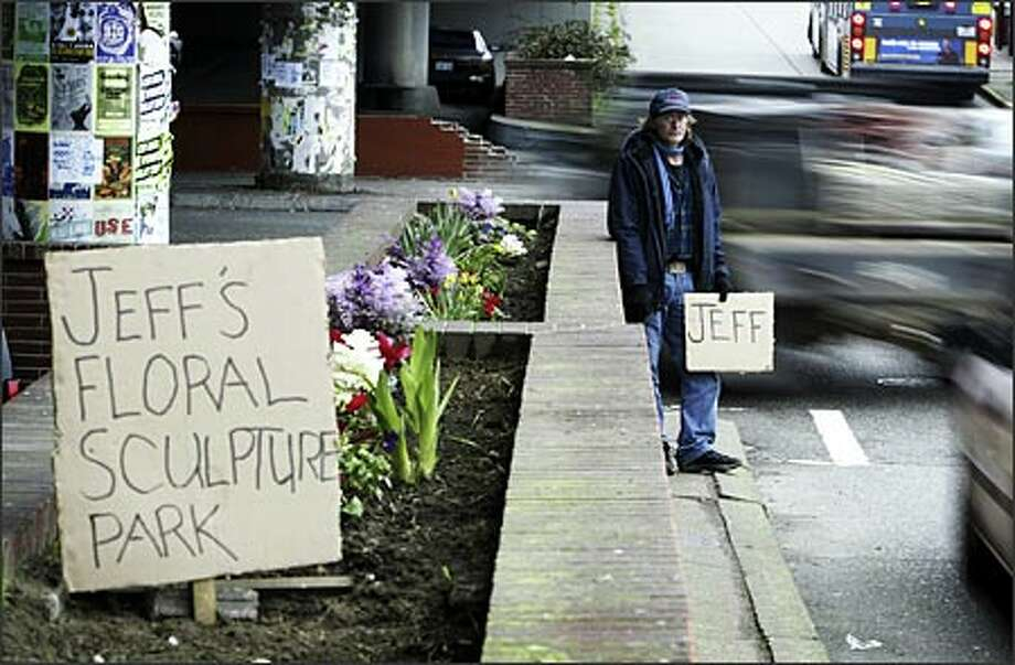 On most days, Jeff Alexander can be found panhandling by the Ballard Bridge while his wife, who has epilepsy, rests in their truck. Alexander, 53, an unemployed commercial fisherman, said he loves to garden, so he started cultivating the old brick planters that line the street. He says it's his way of thanking Ballard residents.Arias:I had just finished an assignment and was looking for a place to have lunch when I made this photo. I don't know why I decided to go by here; it's not one of my usual routes. But I'm sure glad I did. Photo: Gilbert W. Arias, Seattle Post-Intelligencer