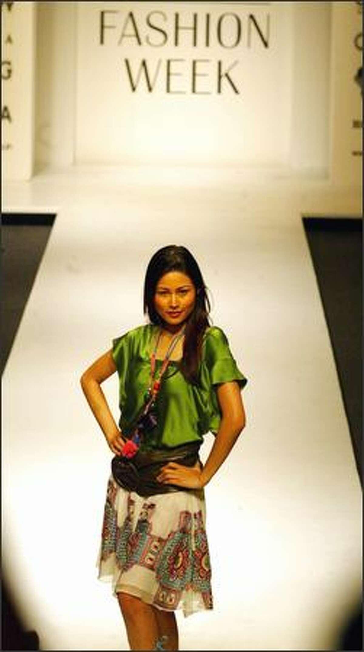 A model presents a creation of designer Vineet Bahi at the Lakme Fashion Week in Mumbai, India, Tuesday. (AP Photo/Rajesh Nirgude)