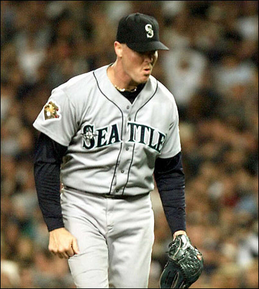 Relief pitcher Jeff Nelson celebrates after the M's turned a double play with the bases loaded.
