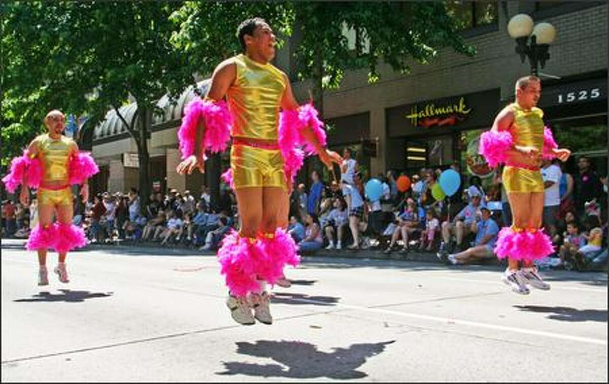 Participants at the annual Gay Pride Parade danced their way down Fourth Avenue in Seattle. (Linna Teng/Seattle University Journalism Summer Workshop)