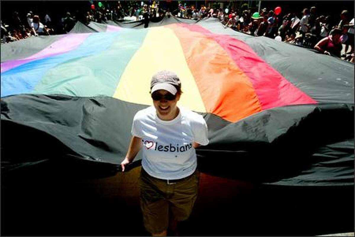 Robin Kirry helped carry the huge flag for Seattle L.G.B.T. Community Center in the annual Gay Pride Parade in Seattle.