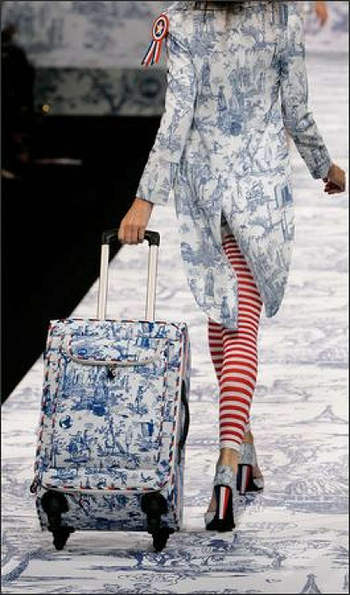 A model presents a creation designed by French fashion designer Jean-Charles de Castelbajac for the presentation of his Spring-summer 2007 ready-to-wear collection, Friday Oct. 6, 2006 in Paris. (AP Photo/Jacques Brinon)