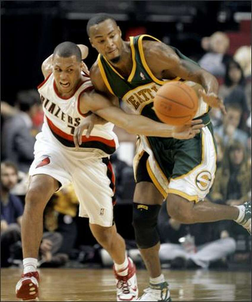 Portland's Brandon Roy tips the ball away from Seattle's Rashard Lewis.