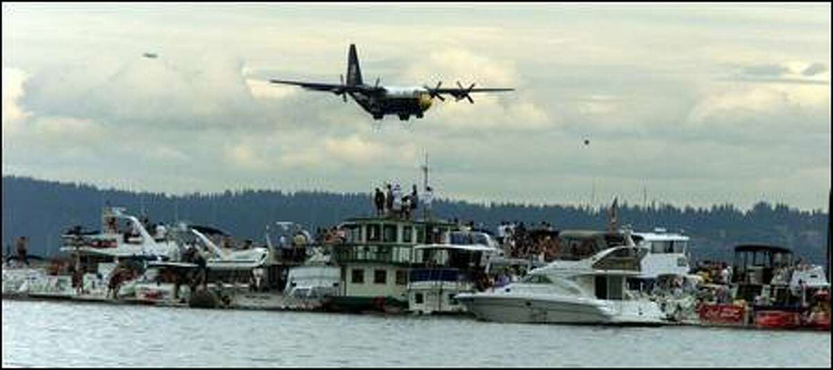 Fat Albert, the transport plane (a C-130) for the Blue Angels, flies of the log boom during the airshow.