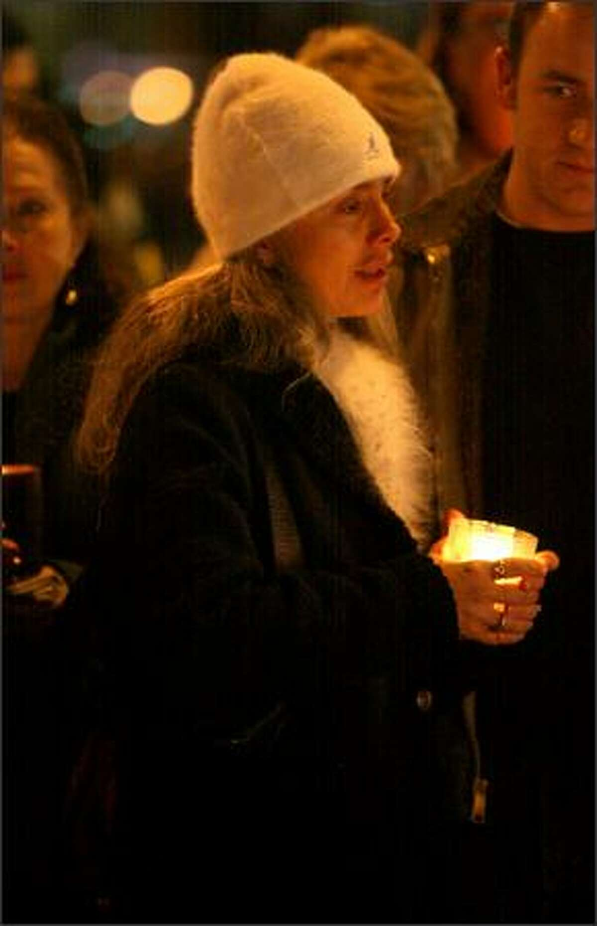 Steve Cox's wife Maria, attends a candlelight vigil and service that were held in front of the King County Sheriff's sub-station in White Center for slain King County Sheriff's Deputy Steve Cox on Tuesday.