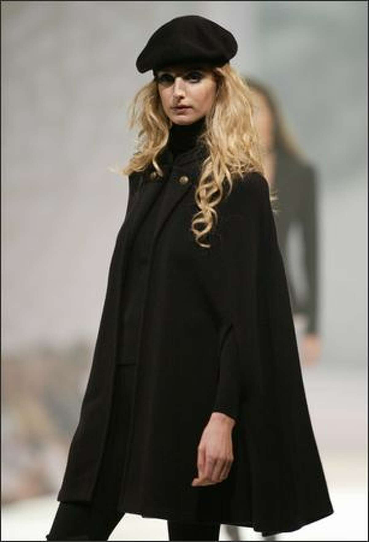 Ponchos? No, capes. Here, a Ralph Lauren wool cape worn with with a beret, cashmere turtleneck and leggings.