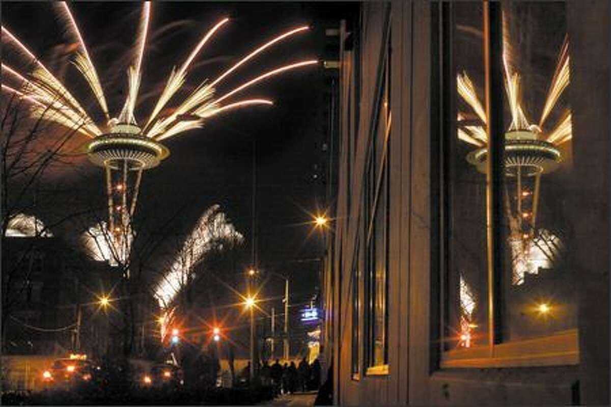 The 2007 New Years fireworks display is launched from the Space Needle shortly after midnight in Seattle.