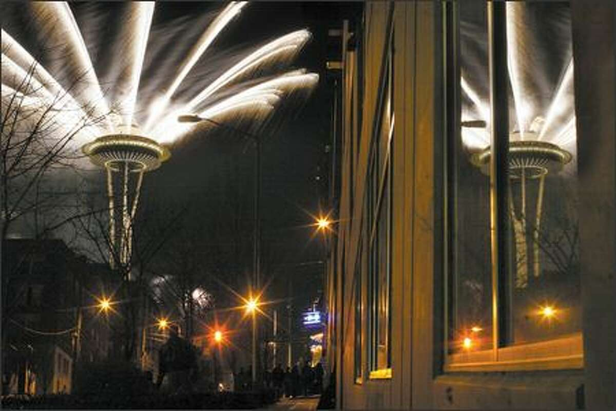 The 2007 New Yearsfireworks display is launched from the Space Needle shortly after midnight in Seattle.