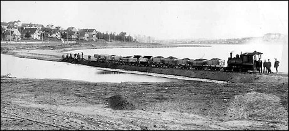 """Green Lake attracts development, 1913: Swamplands around Green Lake were filled during the first decades of the 20th century as the neighborhood, at the end of the city's streetcar lines, grew into one of Seattle's first """"suburbs."""" This view looks across the lake to the southeast from the vicinity of Wallingford Avenue. Photo: Seattle Post-Intelligencer"""