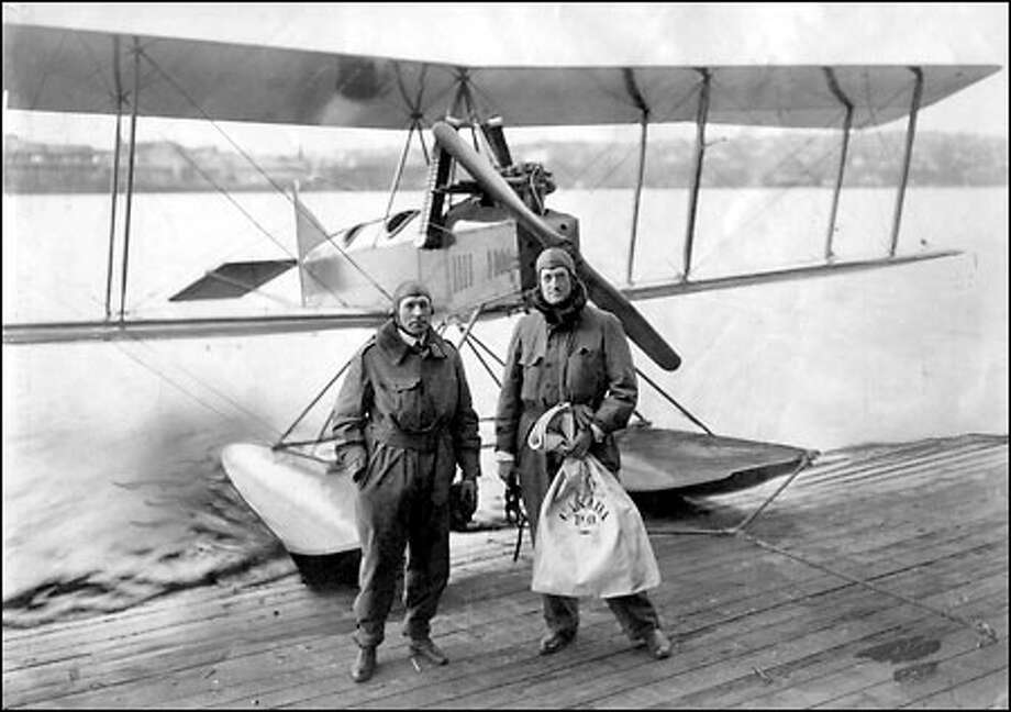 Delivering the mail, 1919: With the economic fortunes of the Boeing Airplane Co. teetering because of the loss of military contracts, William Boeing, right, and test pilot Eddie Hubbard made the first international mail flight from Seattle to Vancouver, B.C, in March 1919. The men are on a ramp on Lake Union next to a Model C seaplane, with Boeing holding the mail. Photo: Seattle Post-Intelligencer
