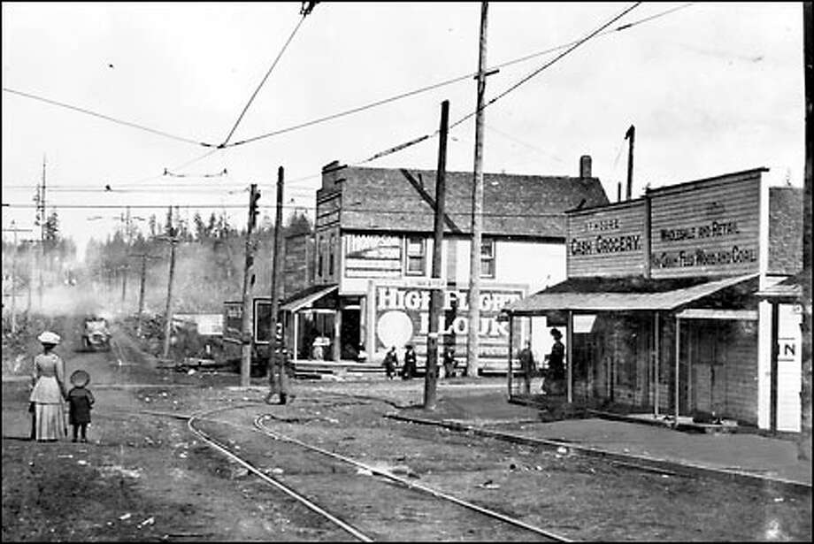 Greenwood district neighborhood, 1920: A mother and her son wait for the Interurban streetcar at North 85th Street and Greenwood Avenue North in 1910. At that time, Interurban service linked the farthest northern reaches of the city with Ballard and other streetcar lines to the south. North 85th Street served as a the longtime north city limit boundary until annexations.Street served as a the longtime north city limit boundary until annexations. Photo: Seattle Post-Intelligencer