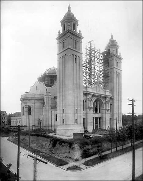 Cathedral rises, circa 1907: The towers of St. James Cathedral, shown here under construction, have