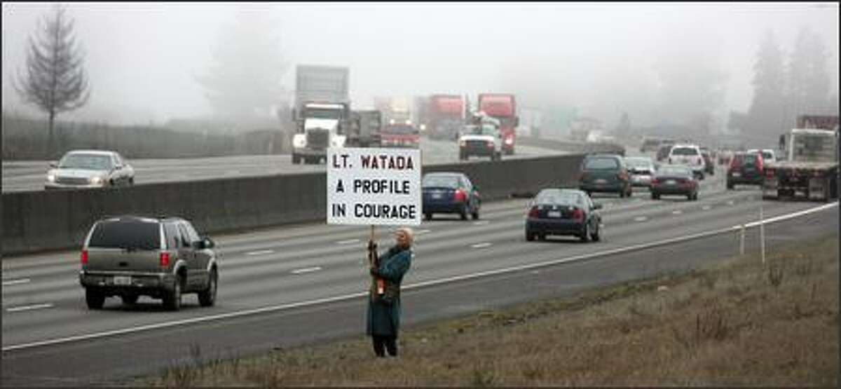 Eiya Wolfe goes down to the edge of I-5 to show her support for Lt. Ehren Watada near the entrance for Fort Lewis.