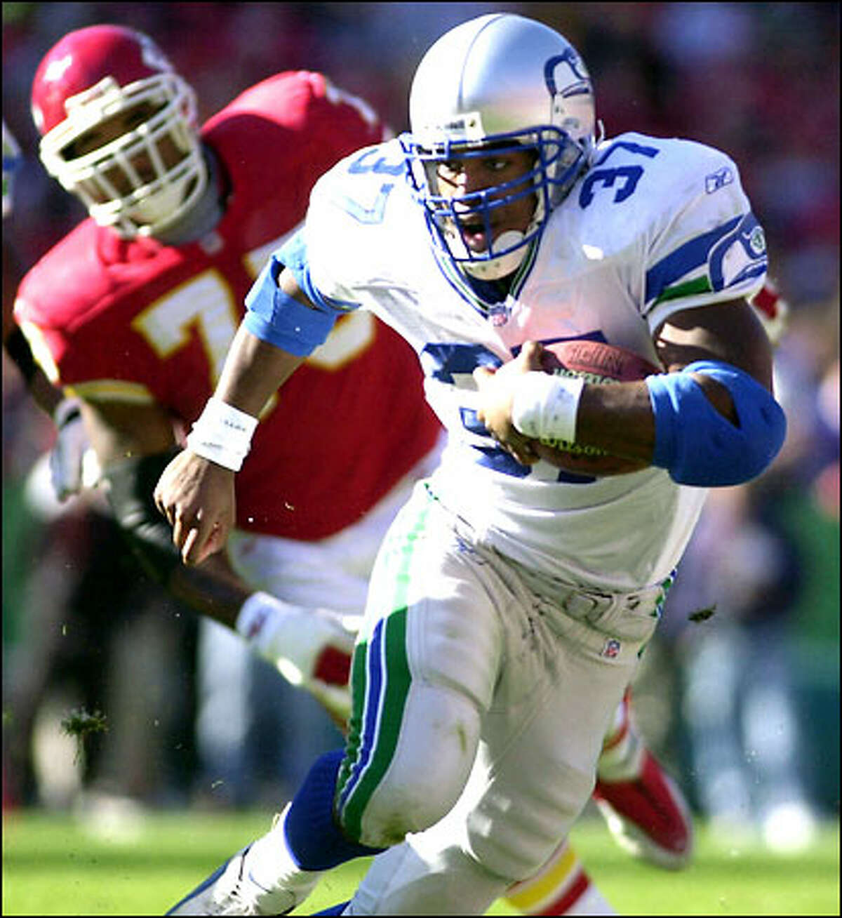 Seahawks running back Shaun Alexander runs past Kansas City's Norris McCleary during the first half. Alexander carried the ball only 13 times for 43 yards.
