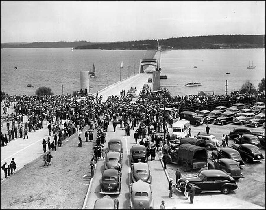 Keeping afloat, 1940: The Lake Washington Floating Bridge, the world's longest floating structure, opened to traffic between Seattle and Mercer Island in July 1940. The first toll was 25 cents for car and driver. In 1967, the bridge was renamed for Lacey V. Murrow, director of the state highway department who envisioned the structure. Photo: Seattle Post-Intelligencer