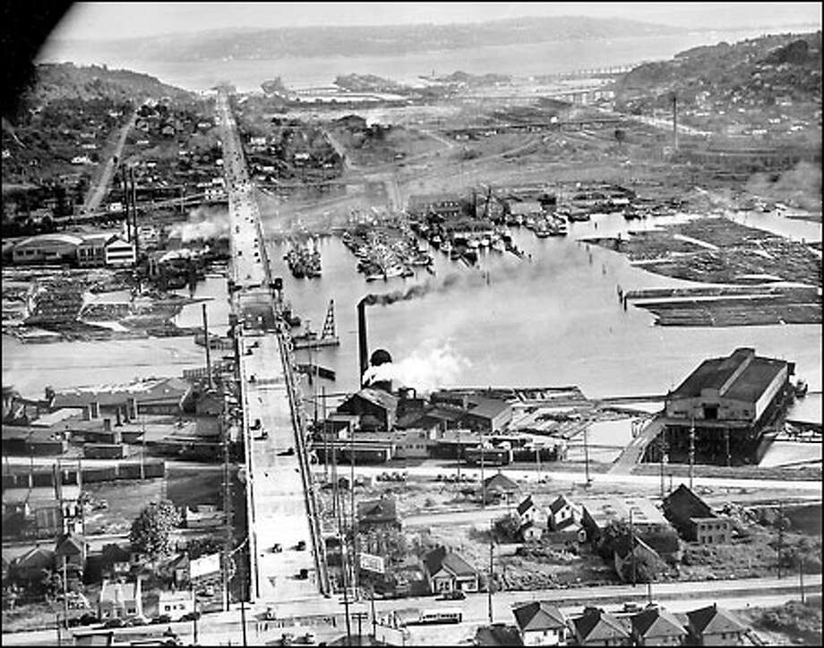 Fishermen's Terminal, 1940: Since 1913, Fishermen's Terminal has served as home to local fleets that travel as far away as Alaska. This 1940 aerial view of the docks next to the Ballard Bridge shows sawmills and lumber mills lining the Lake Washington Ship Canal, with Elliott Bay in the distance beyond Interbay. Photo: Seattle Post-Intelligencer