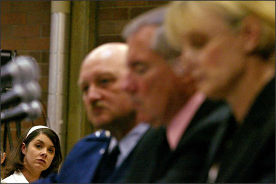 Army veteran Crystal Hampton, left, who served in Afghanistan, listens to testimony at a meeting held yesterday by Sen. Patty Murray at the Army National Guard Armory in Seattle. With her, from left, are Maj. Gen. Timothy Lowenberg and VA officials Max Lewis and Kristine Arnold. Photo: Paul Joseph Brown/Seattle Post-Intelligencer