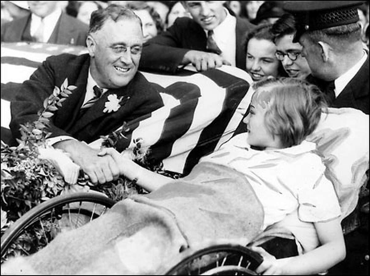 FDR visits Seattle, 1932: Democratic presidential nominee Franklin D. Roosevelt clasps the hand of Melody Bresina at Children's Orthopedic Hospital during a campaign swing through the city on Sept. 20, 1932. Crowds waiting to see FDR gave him a roar of welcome as he stepped off his special train at King Street Station.