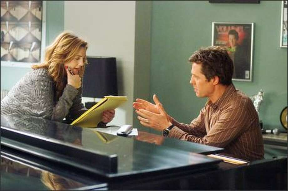 "Drew Barrymore stars as Sophie Fisher and Hugh Grant stars as Alex Fletcher in Warner Bros. Pictures' and Village Roadshow Pictures' romantic comedy ""Music and Lyrics,"" distributed by Warner Bros. Pictures."