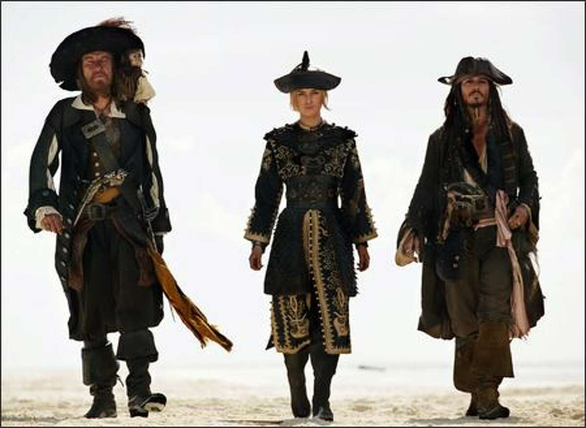 """""""Pirates of the Caribbean: At World's End,"""" with, left to right, Geoffrey Rush, Keira Knightley and Johnny Depp (DISNEY ENTERPRISES, PETER MOUNTAIN / AP)"""