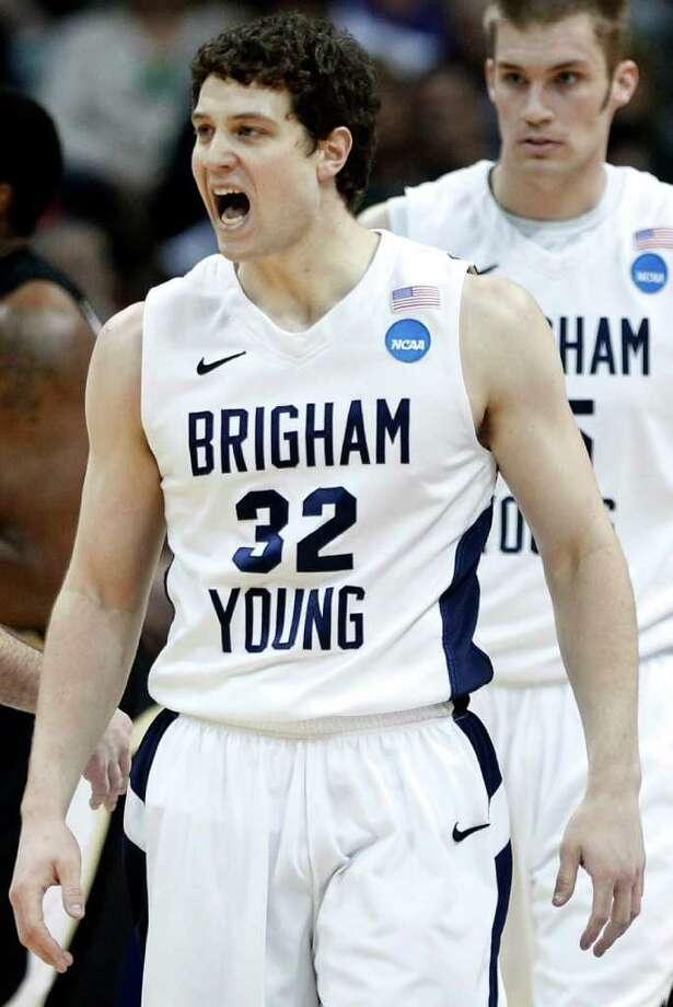 BYU guard Jimmer Fredette (32) reacts in the first half against Wofford during a Southeast regional second round NCAA tournament college basketball game, Thursday, March 17, 2011, in Denver. (AP Photo/Ed Andrieski) Photo: Ed Andrieski