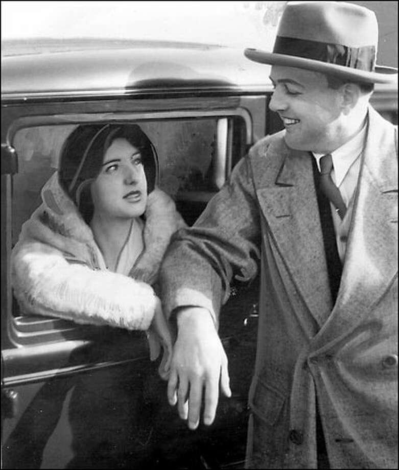 Bootlegger Roy Olmstead after his 1931 release from McNeil Island prison. At left is his wife, Elsie. Photo: Seattle Post-Intelligencer