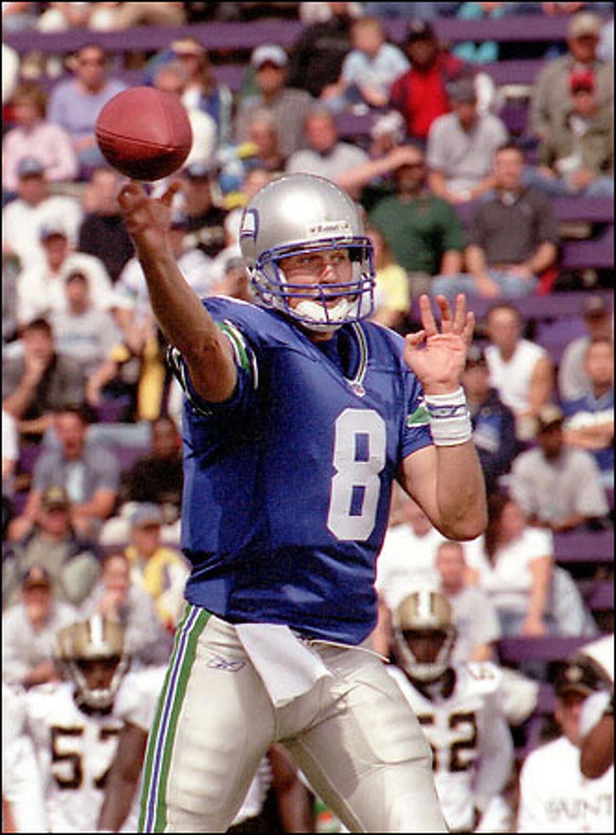 Seahawks quarterback Matt Hasselbeck sends a pass to Karsten Bailey for a touchdown in the first quarter.