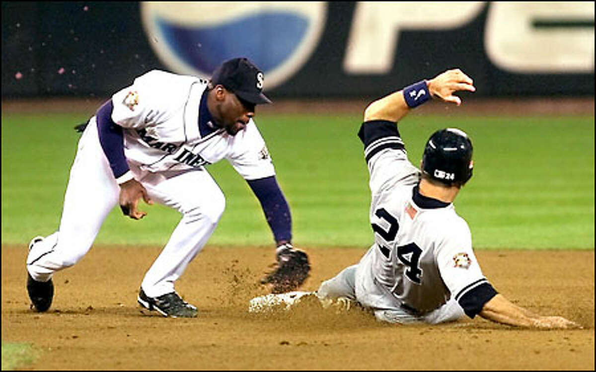 Mark McLemore takes out Yankees Tino Martinez in the 6th inning.