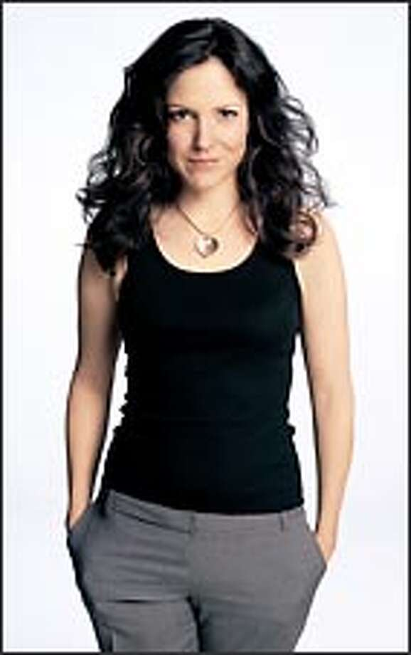 """Mary-Louise Parker plays Nancy, a mom who sells pot to support her family, in the new Showtime comedy """"Weeds."""" Photo: Showtime / ©Showtime 2005"""