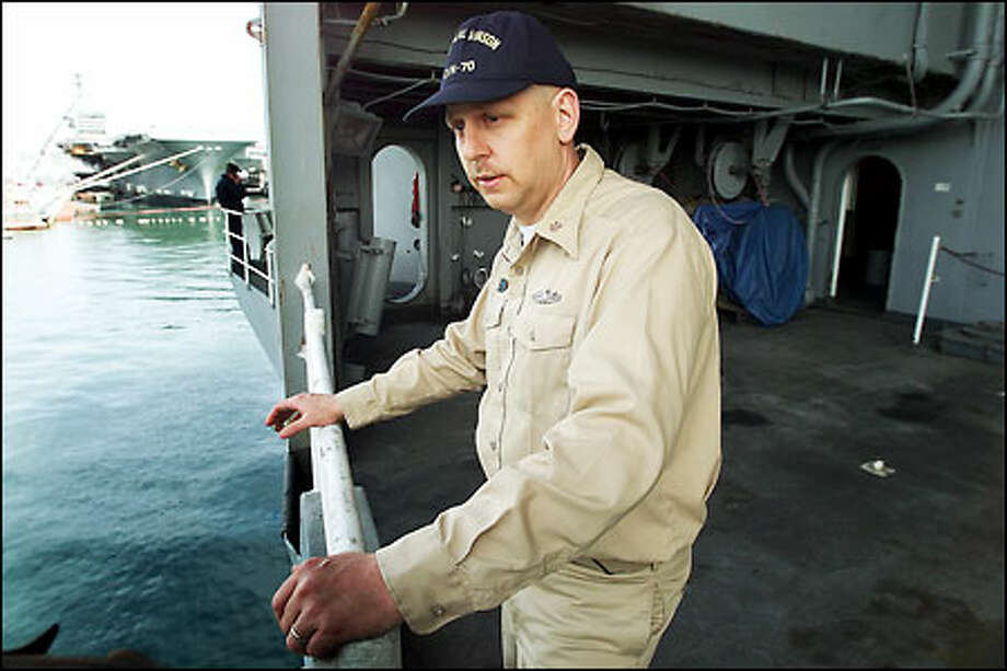 Chief Petty Officer Charles Roberts takes a break from his watch. Photo: Gilbert W. Arias, Seattle Post-Intelligencer