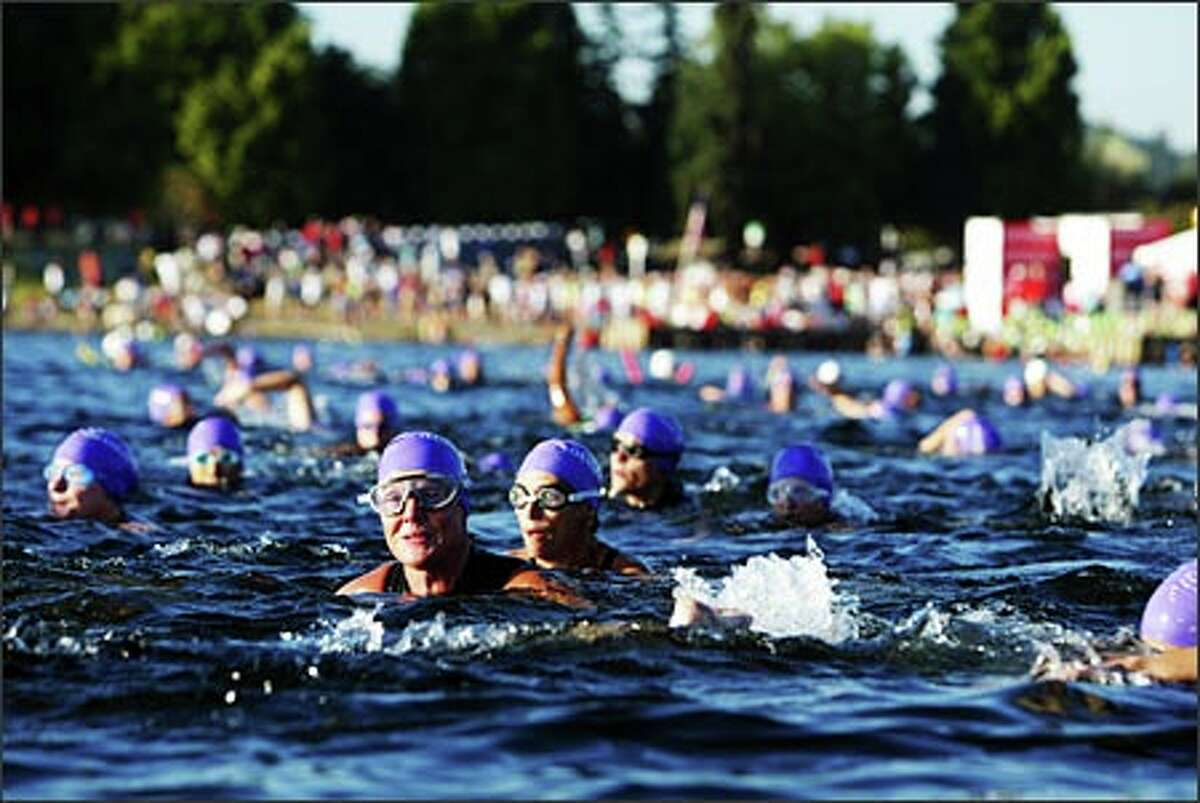 More than 4,300 women begin the first leg of the Seattle Danskin Women's Triathlon in Genesee Park. Danskin says it's the world's largest women's triathlon.Ducey: I love this woman's game face. It's the real deal.