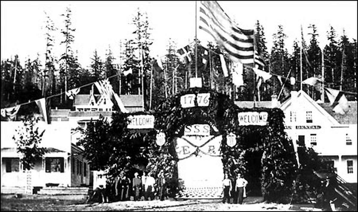 An old-fashioned Fourth, 1865: Seattle pioneers gather at the corner of First Avenue and James Street next to celebrate the Fourth of July in 1865. The landmark Pioneer building and
