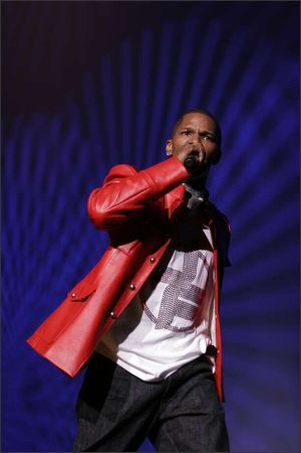 Jamie Foxx begins his concert with at KeyArena with a comedy routine. He played Seattle as part of his Unpredictable Tour. Photo: Meryl Schenker, Seattle Post-Intelligencer