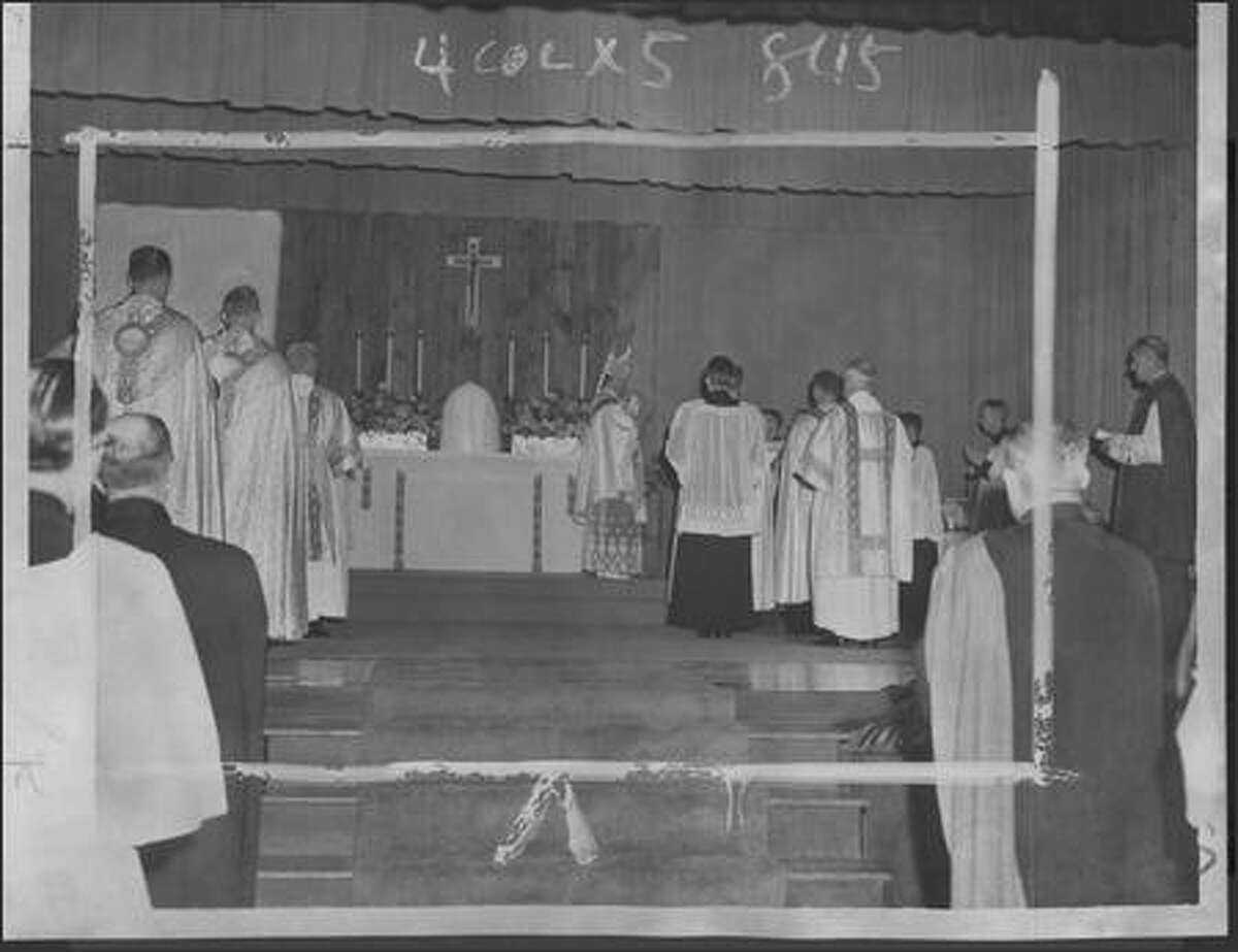 Before a crowd in the St. Edward's Seminary gymnasium, the Most Rev. Thomas A. Connolly, Archbisho of Seattle, pontificates at high mass on October 21, 1956.