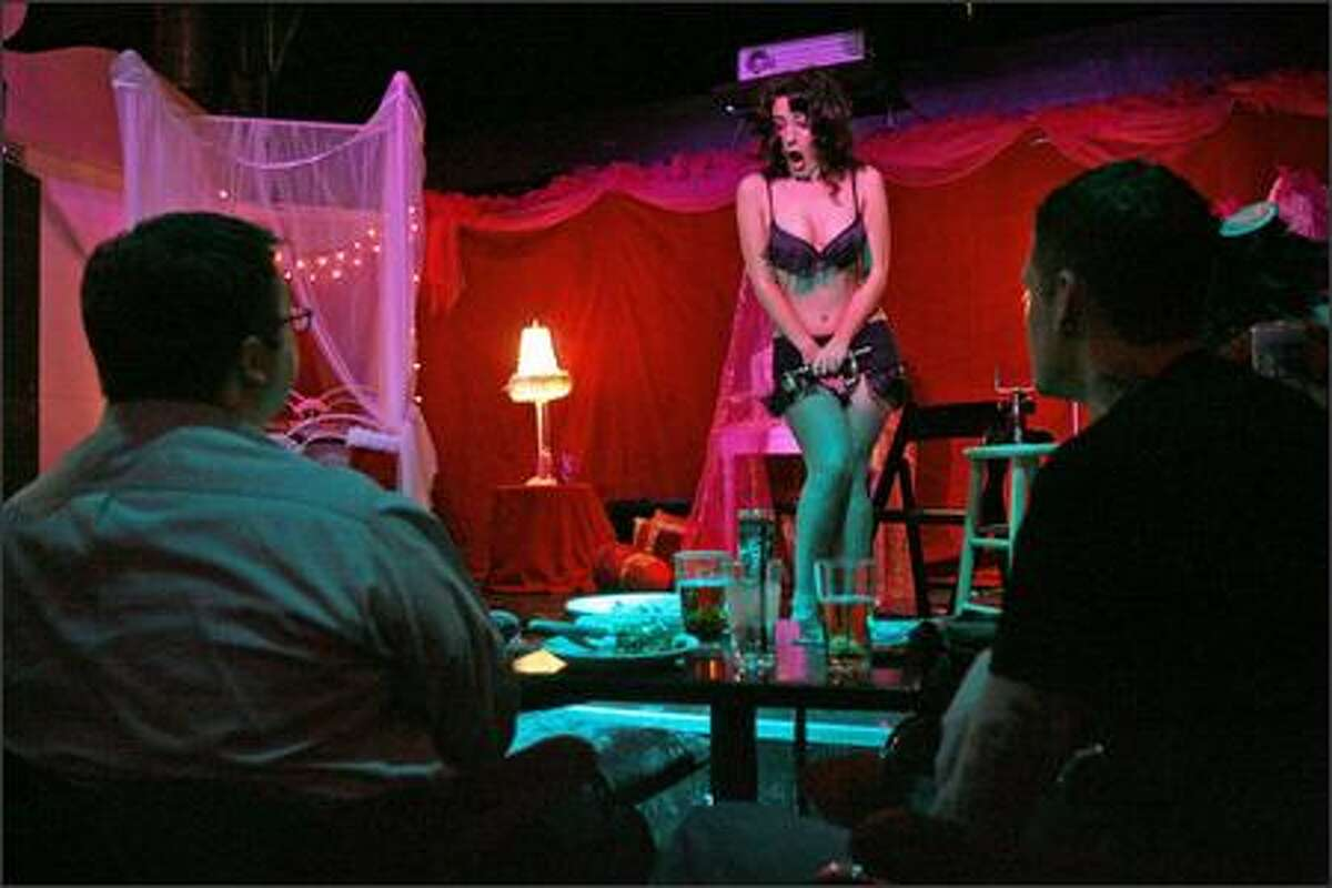 Burlesque dancer Belle Cozette, of Seattle, almost dropped the phone for the dinner crowd at the Last Supper Club during its