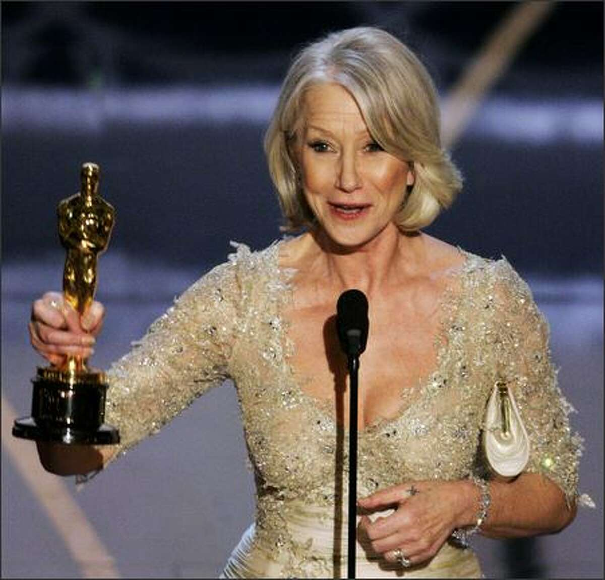 British actress Helen Mirren accepts the Oscar for best actress for her work in