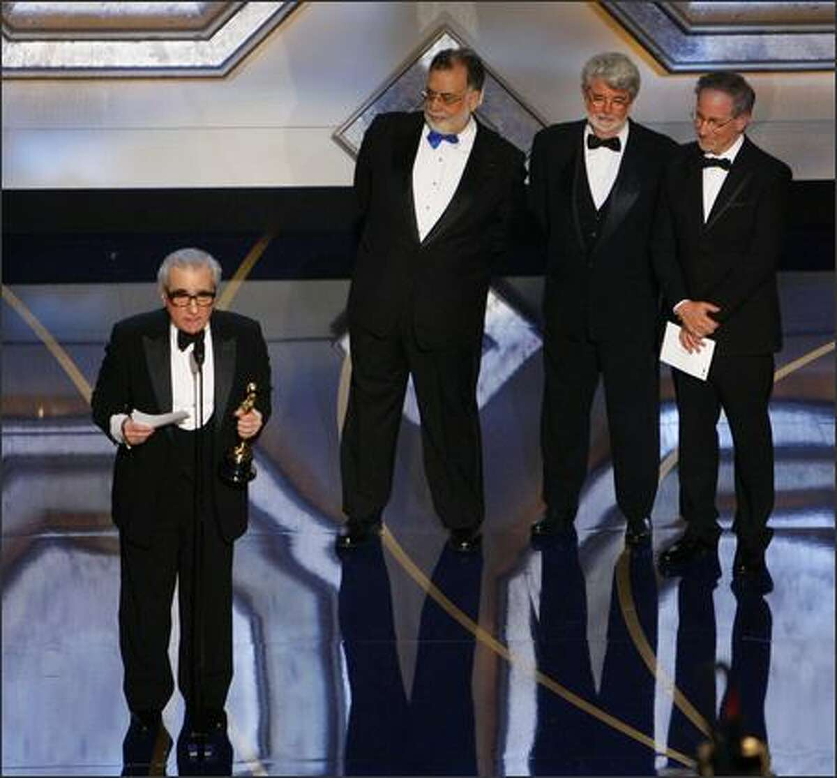 Director Martin Scorsese accepts the Oscar for best director for his work on