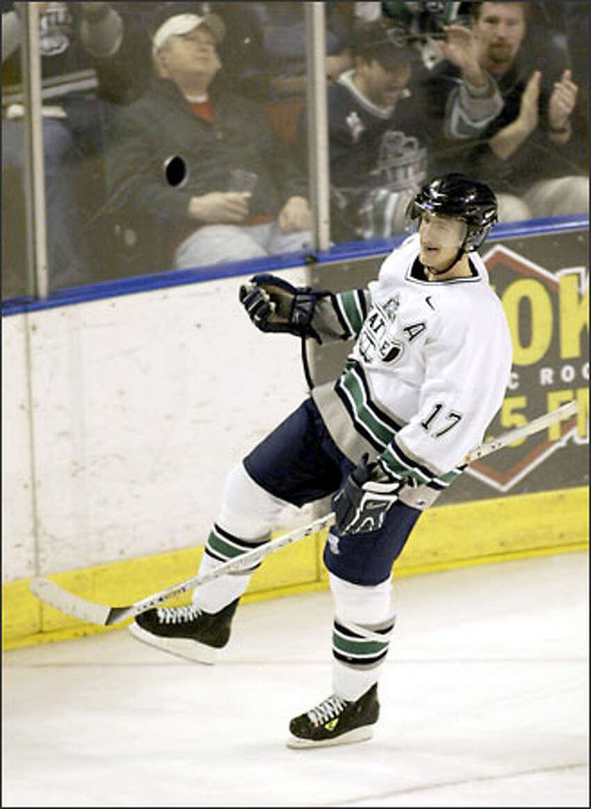Seattle Thunderbirds Brooks Laich skates around the ring after scoing a goal against the Chiefs.