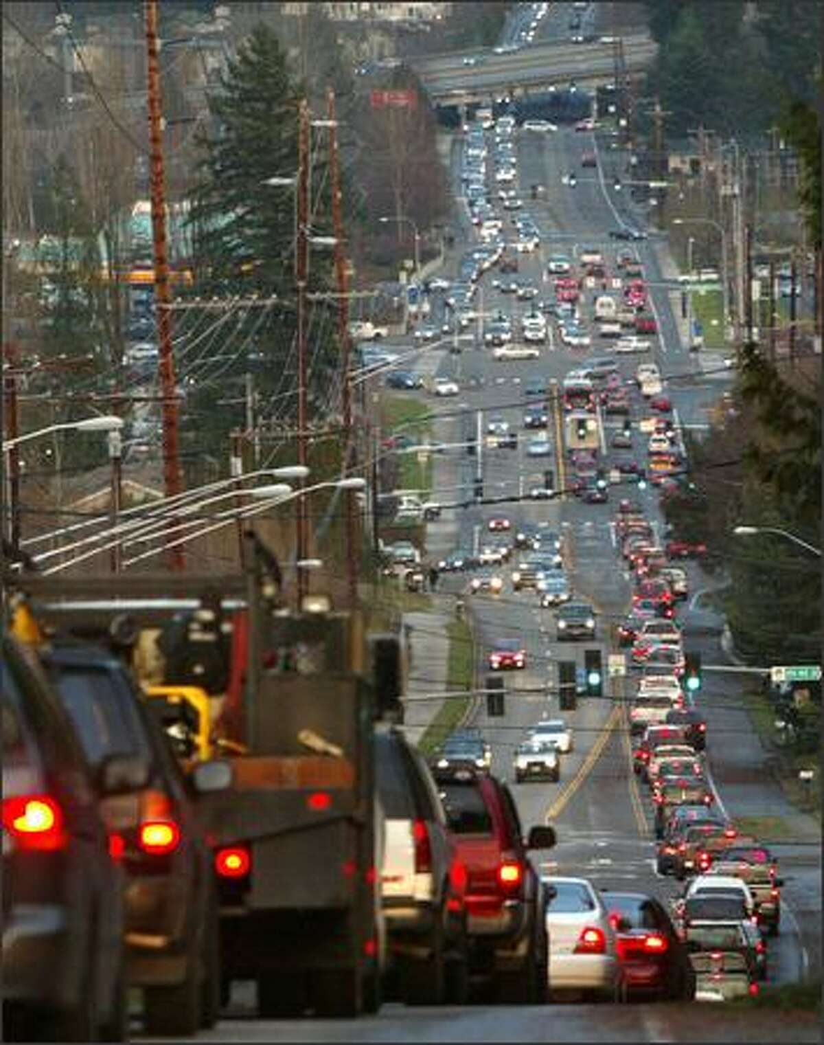 Traffic back up on roads in South Snohomish County Friday after winds downed trees and power lines throughout much of the area. Drivers trying to get around major backups clogged even minor streets and backgrounds. Seattle Post-Intelligencer / Grant M. Haller