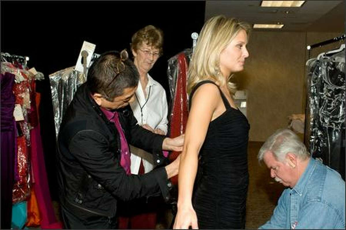 During registration and fittings for the 2007 Miss USA competition at the Wilshire Grand Hotel in Los Angeles on March 8, Pete Menefee (right) and designer Tadashi do a personalized dress fitting with Erin Abrahamson, Miss New Jersey USA 2007. Each Miss USA contestant will compete in a unique Tadashi dress during the broadcast on March 23.