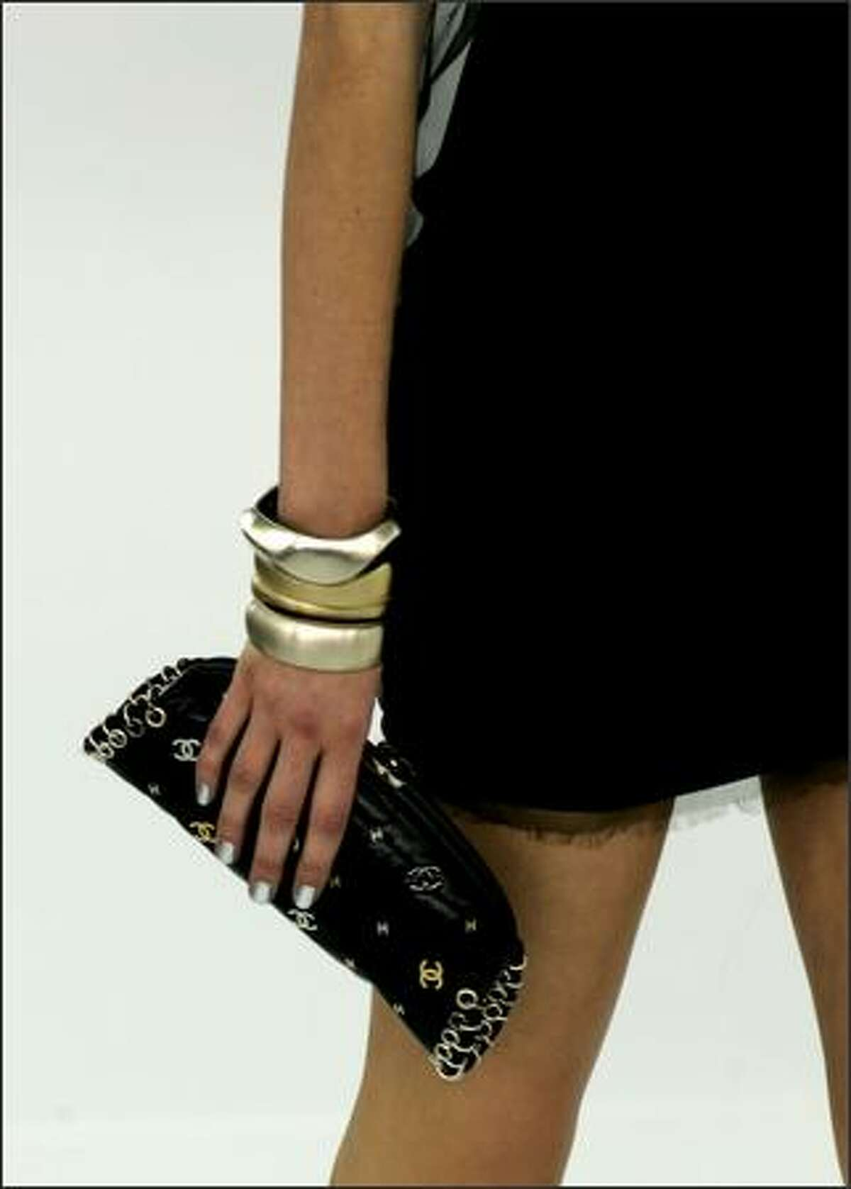 A moldel holds a handbag designed by German fashion designer Karl Lagerfeld for Chanel's spring-summer 2007 ready to wear collection, presented, Friday Oct., 6 2006. (AP Photo/Jacques Brinon)