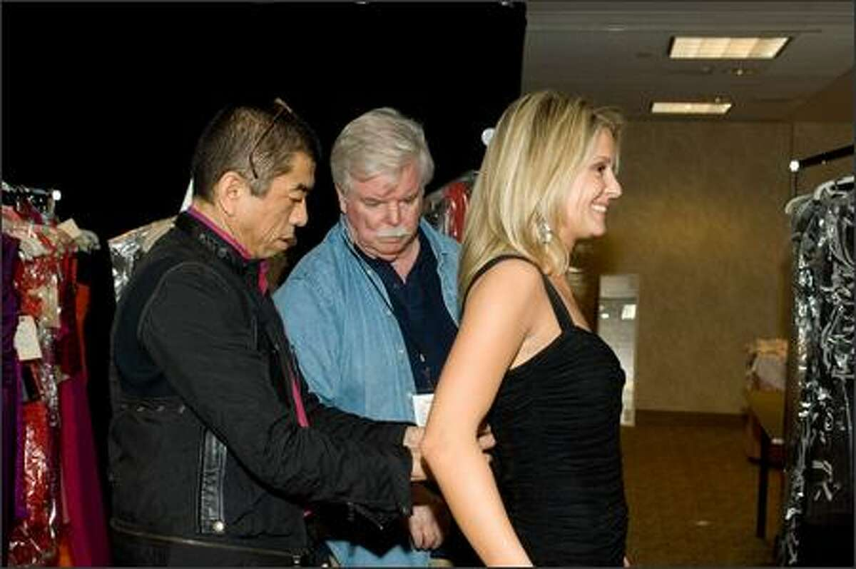 Pete Menefee and designer Tadashi do a fitting with Erin Abrahamson, Miss New Jersey USA 2007.
