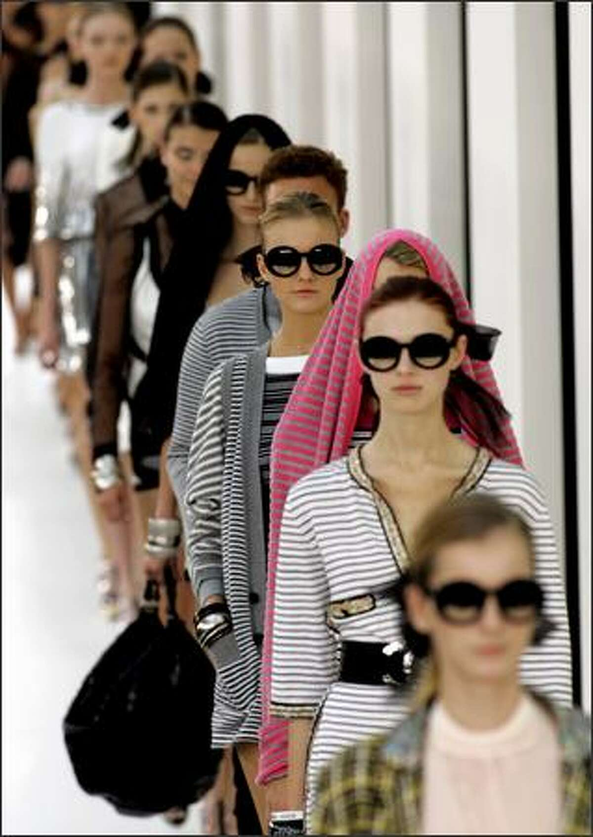 Models wear creations designed by German fashion designer Karl Lagerfeld for Chanel's spring-summer 2007 ready to wear collection, presented Friday Oct. 6, 2006. (AP Photo/Jacques Brinon)